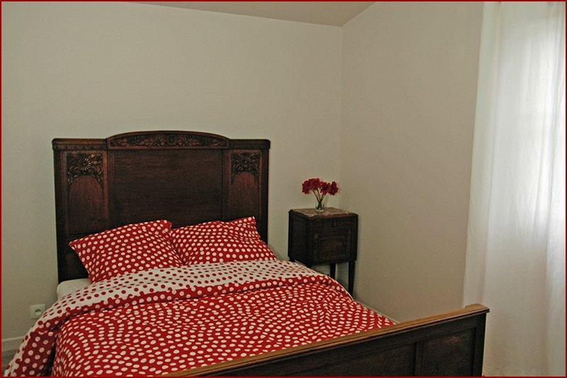Eén van de vijf slaapkamers.